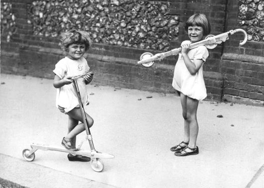Two girls with scooters public domain Australia