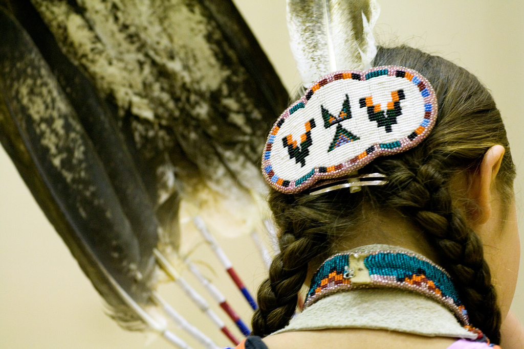 Feathers, braids, and beads by Nic McPhee, flickr